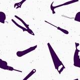 Texturas inconsútiles de las herramientas de la construcción el martillo de la silueta vio cinta métrica de taladro de la llave d foto de archivo