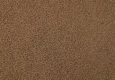 Texturbakgrund av den bruna plast- dörrmattan Royaltyfria Foton