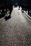 texturbakgrund av den kullersten stenlade gatan Royaltyfri Bild