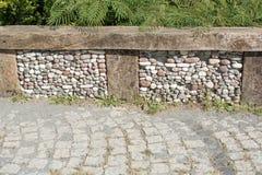 texturbakgrund av den kullersten stenlade gatan Fotografering för Bildbyråer