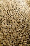texturbakgrund av den kullersten stenlade gatan Royaltyfria Bilder