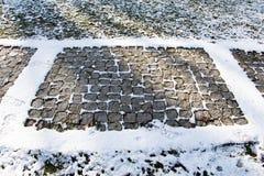 texturbakgrund av den kullersten stenlade gatan Arkivfoton