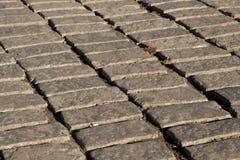 texturbakgrund av den kullersten stenlade gatan Royaltyfri Fotografi