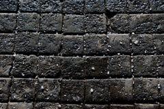 texturbakgrund av den kullersten stenlade gatan Arkivbilder
