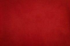 Texturbakgrund av den röda tygtextilen Arkivfoton