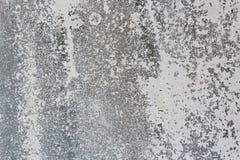 Texturbakgrund av slitningsbetongväggen Arkivbild