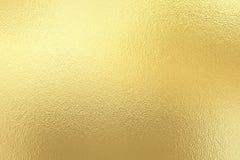 Texturbakgrund för guld- folie arkivfoton
