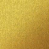 Texturbakgrund för guld- folie Arkivbilder