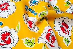 Texturbakgrundsmodell blom- modell på en gul backgroun Fotografering för Bildbyråer