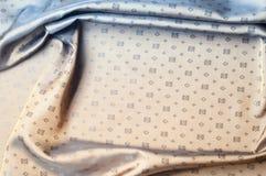 Texturbakgrundsmodell Brunt siden- tyg Abstrakt backgrou Royaltyfria Foton