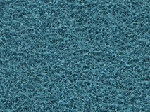 Texture. Cyan abrasive sponge of the plastic, close-up Stock Photos
