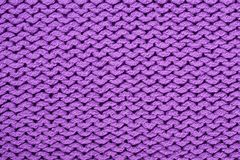 Texture. A violet wave texture of knitted wool Stock Photos