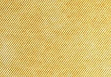 Texture. Yellow velveteen texture background, diagonal lines Royalty Free Stock Photos