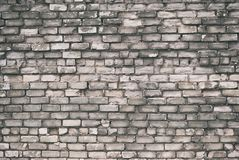 Texture of aged brick wall with cracked weathered structure white gray color close-up. Texture of brick wall with cracked weathered structure white gray color royalty free stock images