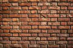 Texture of aged red brick wall with cracked weathered structure close-up. Texture of brick wall with cracked weathered structure red white color close-up for royalty free stock image