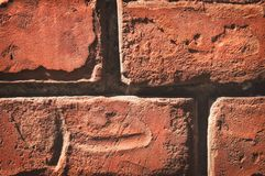 Texture of aged red brick wall with cracked weathered structure. Texture of brick wall with cracked weathered structure red white color close-up royalty free stock photos