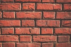 Texture of aged red brick wall with cracked weathered structure. Texture of brick wall with cracked weathered structure red white color close-up stock photos