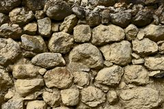 The texture of an ancient destroyed stone wall. royalty free stock photo