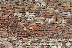 Ancient rough stone wall texture. Texture of ancient wall built of uneven rough stone blocks Stock Photography