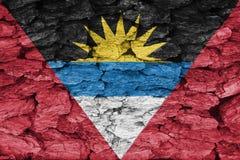 Texture of Antigua and Barbuda flag. The texture of Antigua and Barbuda flag  on a decorative dry tree bark Stock Image