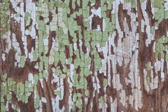 Vintage Wooden Surface With Scraped Green Paint Creates Background. Texture of antique wooden surface with cracked, scraped green paint royalty free stock photography