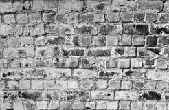 Texture approximative noire et blanche de briques image stock
