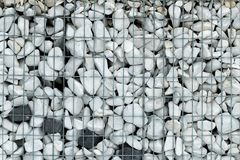 Texture background for architecture, construction and landscape design metal mesh and crushed stone Royalty Free Stock Image