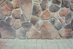 Texture - artificial decorative stone façade. Decorative grey color rough stone wall background texture. Wall of decorative brick. Artificial stone stock photo
