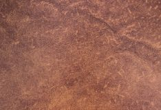Texture artificial leather brown color. stock images