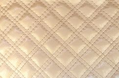 Texture artificial leather ivory color diamond with stitched stitch stock photos