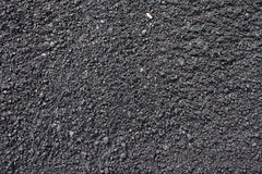 Texture of asphalt background. A rough, pebbled background of the surface of asphalt pavement Royalty Free Stock Photography