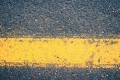 Texture of asphalt closeup. Background tracks closeup. Royalty Free Stock Photo