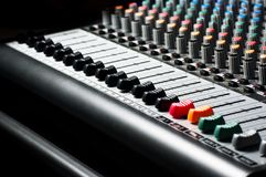 Texture of an audio sound mixer. Part of an audio sound mixer with buttons stock photos