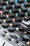 Texture of an audio sound mixer. Part of an audio sound mixer with buttons royalty free stock image