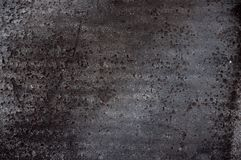 Texture background. Black ruberoid material with hollows Stock Images