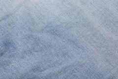 Texture background of blue jeans material Stock Images