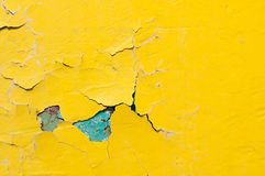 Texture background of bright yellow and blue peeling paint on the old rough texture surface Royalty Free Stock Images