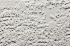 Texture, background, bumpy wallpaper painted cream Stock Image