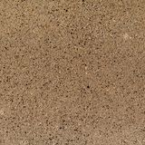 Texture background of composite stones similar to brown granite stock image