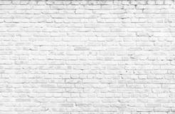 Texture background concept: white brick wall background in rural room. Rehabilitation concept: Silhouette a disabled man standing up and raising his crutches at stock photo