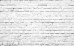 Texture background concept: white brick wall background in rural room. Rehabilitation concept: Silhouette a disabled man standing up and raising his crutches at royalty free stock photo