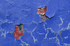 Texture background of dark blue and red peeling paint on the old rough texture surface Stock Images
