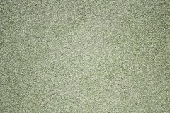 Wall of gravel, the back background is green. picture for the inscription. copyspace royalty free stock photography