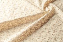 Texture background of fabric. Beige fabric with punctured circle. S. Beige background. Abstract geometric pattern of dots, lines. Graphic modern pattern. Neutral royalty free stock photo