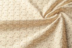 Texture background of fabric. Beige fabric with punctured circle. S. Beige background. Abstract geometric pattern of dots, lines. Graphic modern pattern. Neutral stock images