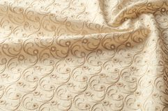 Texture background of fabric. Beige fabric with punctured circle. S. Beige background. Abstract geometric pattern of dots, lines. Graphic modern pattern. Neutral stock photography