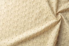 Texture background of fabric. Beige fabric with punctured circle. S. Beige background. Abstract geometric pattern of dots, lines. Graphic modern pattern. Neutral stock photo