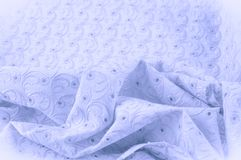 Texture background of fabric. Cloth with perforated circles. The. Texture of the fabric is painted in pastel colors of blue, Close Up of Blue Cotton Fabric Stock Photos