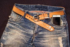 Texture background of jeans , belt detail with mobilephone and e Royalty Free Stock Image