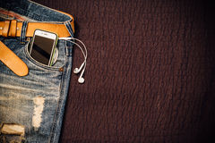 Texture background of jeans , belt detail with mobilephone and e Stock Image